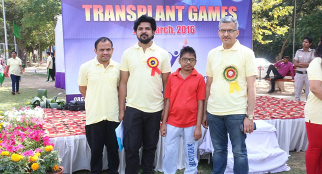 The boy in red is a pancreas & kidney transplant patient at the annual athletic meet of transplant patients